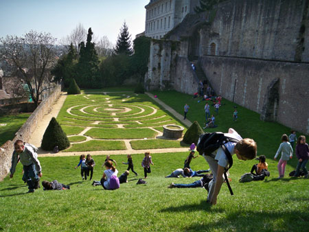 Children rolling down in Chartres Cathedral garden